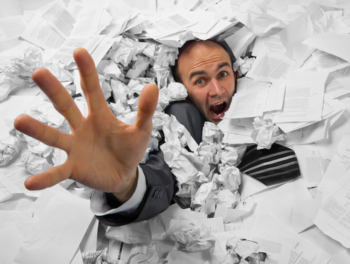 BusinessmanDrowingInPaper How failure to use technology is costing small businesses