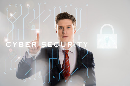 BusinessmanPointingToCyberSecuritySign Brexit and SMEs: Dealing with Cyber Security and Data Protection