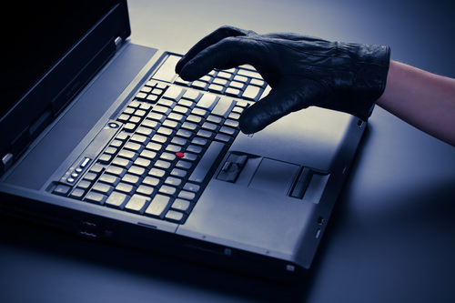 CriminalUsingLaptop The Continuing Threat of Cybercrime to SMEs