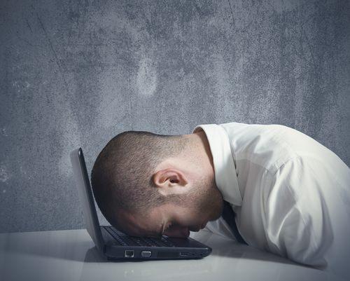 ManHeadOnLaptop Six ways UK SMEs fall victim to cybercrime
