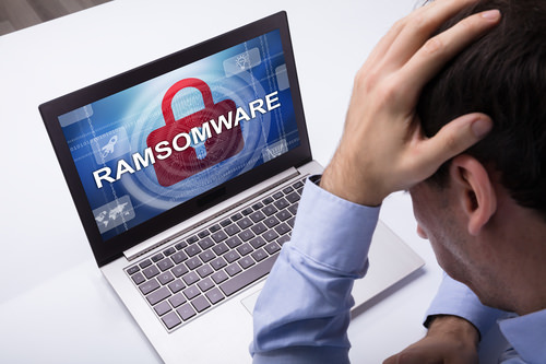 RansomwareShowingOnLaptop Six ways UK SMEs fall victim to cybercrime